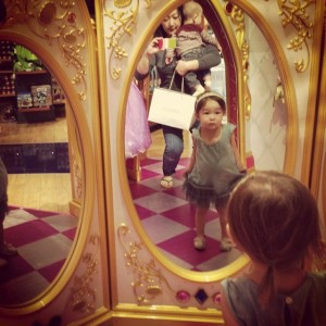 """So apparently these mirrors only talk to you if you have an official Disney princess dress on or a wand in hand. Bea kept trying to find the 'magic' in her dress to have the fairy god-mothers come alive as other girls in their plasticky outfits came by."" (photo by Flickr user sherrymain)"