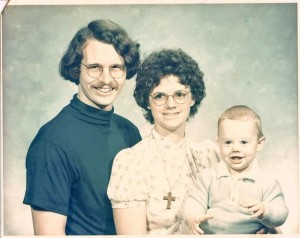 Family snapshot of Arrington de Dionyso (age 1) with his parents, 1976.