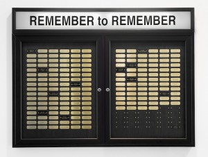 "Cheryl Pope, ""Remember to Remember"" (2013), metal display case, brass name plates, fluorescent light (courtesy Monique Meloche Gallery)"